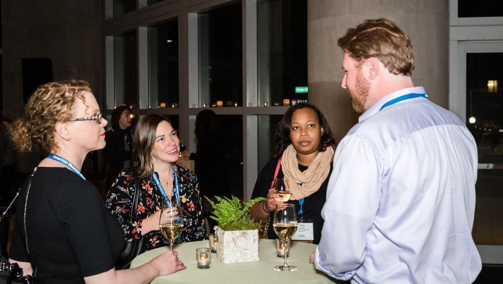 AMMC attendees networking at reception in Seattle.